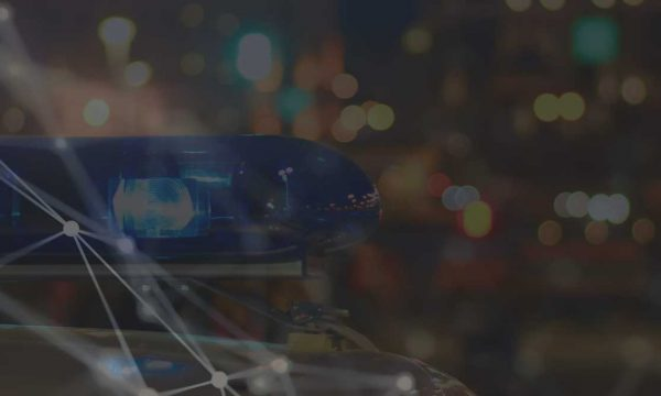 Close up image of a Police car with blue lights turned on