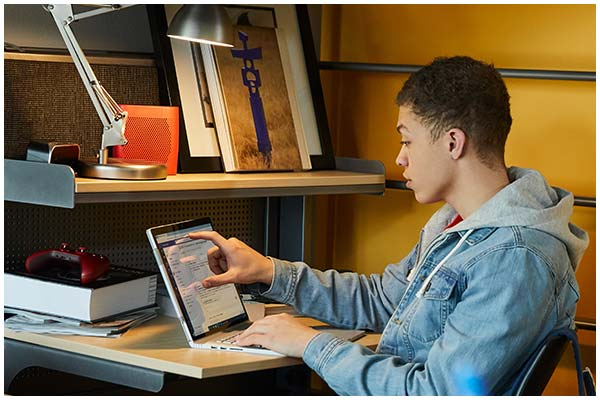 Student working at home on a surface device
