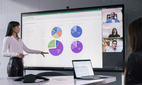 Woman presenting on a Microsoft Hub s2