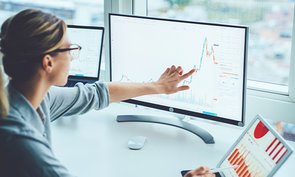 Woman analyzing data on a computer monitor