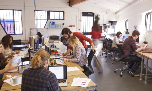 Office workers in open plan office space