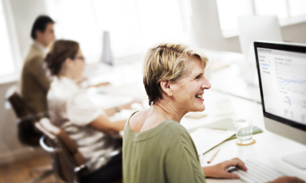 Lady smiling away from computer