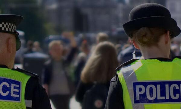 police officers walking in street