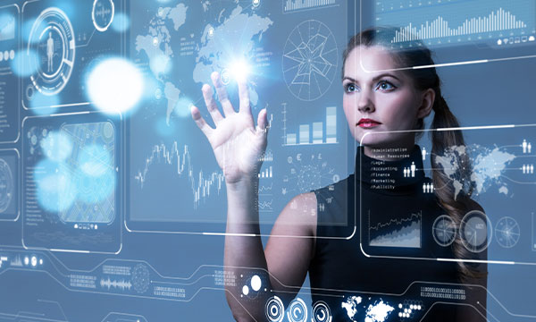 Business woman looking at a visualization of lots of data sets