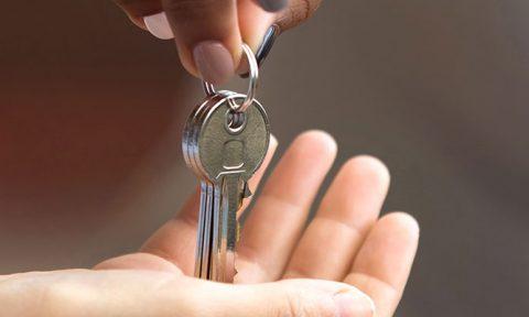 someone handing keys over