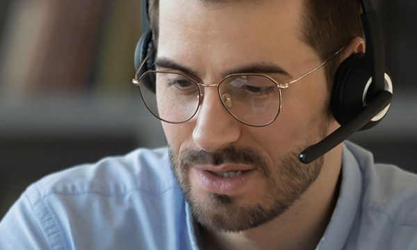 teacher talking with headset on