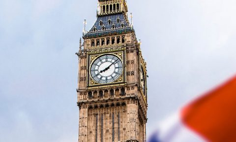 Union Flag waving in front of Big Ben and the Houses of Parliament