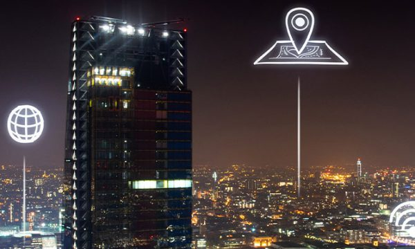 Ariel shot of London at night with icons of IoT Devices